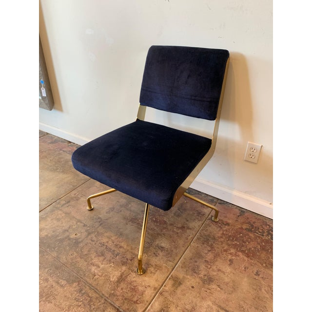 Contemporary brass desk chair with gently worn blue velvet fabric. The velvet is rayon.
