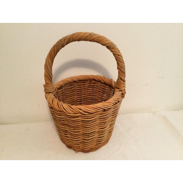 """Wicker woven basket. 10"""" tall, 13"""" wide, 9 1/2"""" deep."""