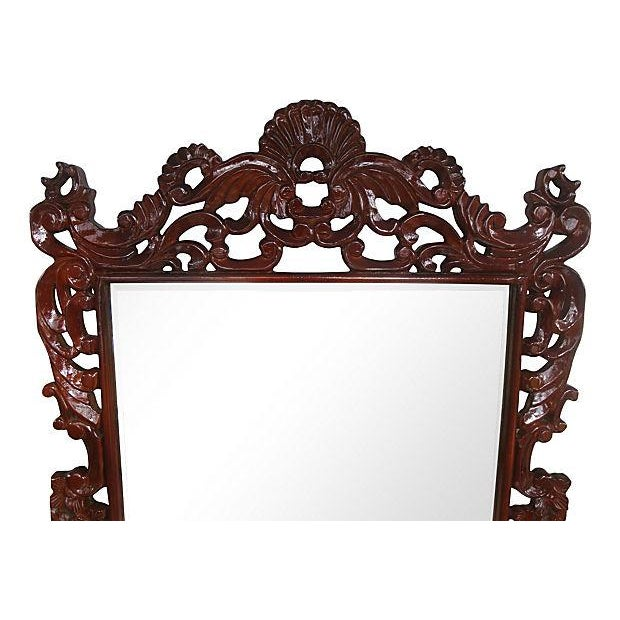 Very large statement maker wall mirror with an Italian flair. Elaborate carved filagree work including a curved plume at...