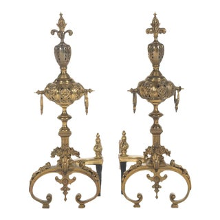 Pair of Pierced Brass Andirons,Ornately Styled Brass, Grotesque Masks Motifs, Foliate Designs, Pierced Work Decoration, Ring Handles at the Sides For Sale