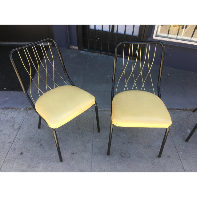 Amazing set of Mid-Century Dining Chairs. Gorgeous sculptural matte black frames of steel tubing, accent solid brass backs...