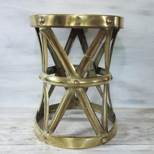 A wonderful, vintage brass drum table with lattice frame and brass stud details. This versatile piece can be used in so...