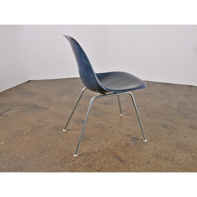 We have a large group of original 1960s Eames navy blue fiberglass shell chairs. Price is for the H-base as pictured,...