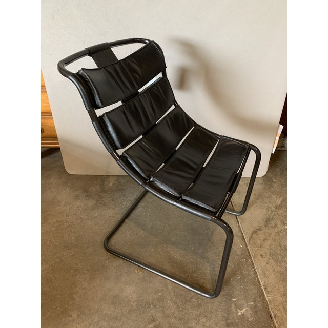 Black metal frame and leather side chair