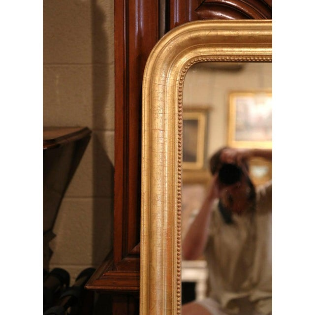 Decorate an entry or a powder room with this elegant antique mirror. Crafted in the Burgundy region of France, circa 1860,...