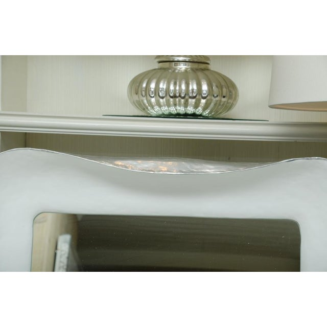 Very attractive pair of white plaster mirrors with silver gilt side trim. The mirrors can be sold individually.