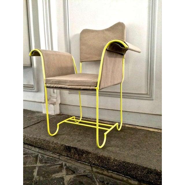 "Mathieu Mategot rare set of 4 arm chairs model ""Tropiques""."