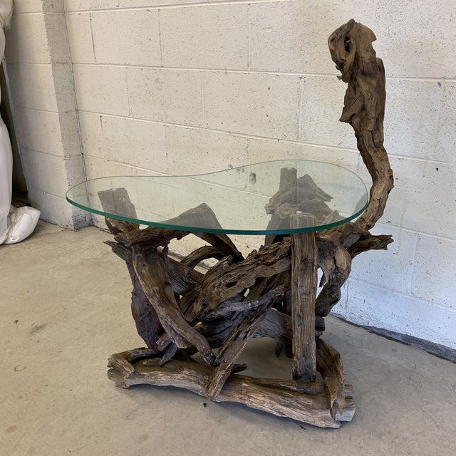 This is the coolest driftwood table. Really great shape ( glass top is kidney shaped) and makes it perfect go between...
