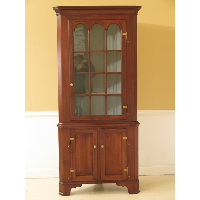 Pair of Benchmade Chippendale style walnut corner cabinets. Features solid walnut, bracket feet, high quality...
