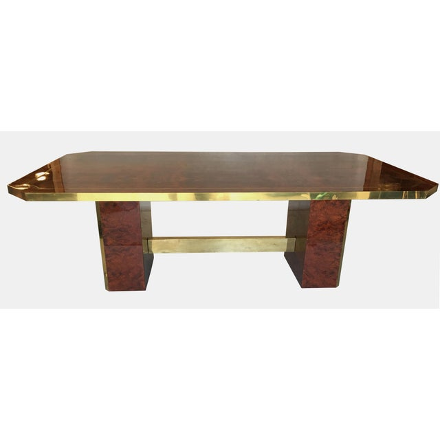 Super chic 1980s dining table in cedar burl with brass trim by Jean-Claude Mahey. The vibrant matched grain burl top is...