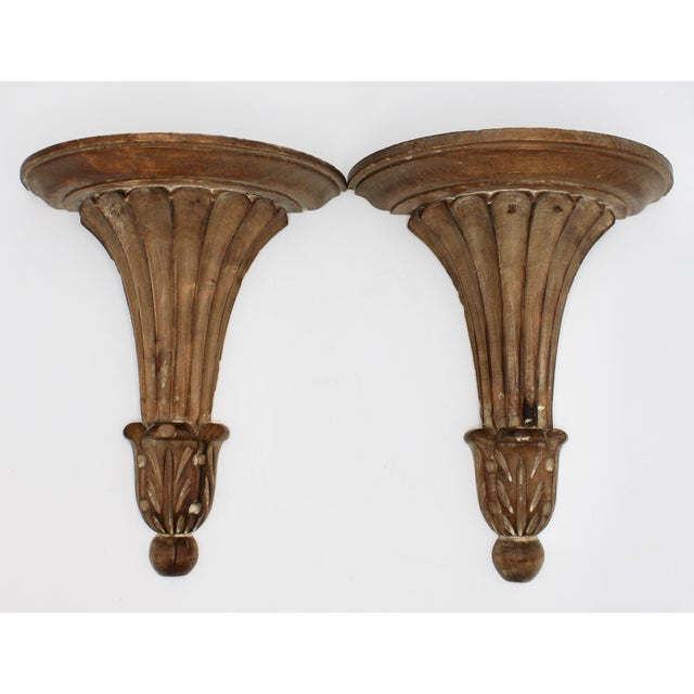 A superb pair of Italian wall shelves composed of wood. An ornate, sculptural design; Italy is stamped on the reverse.