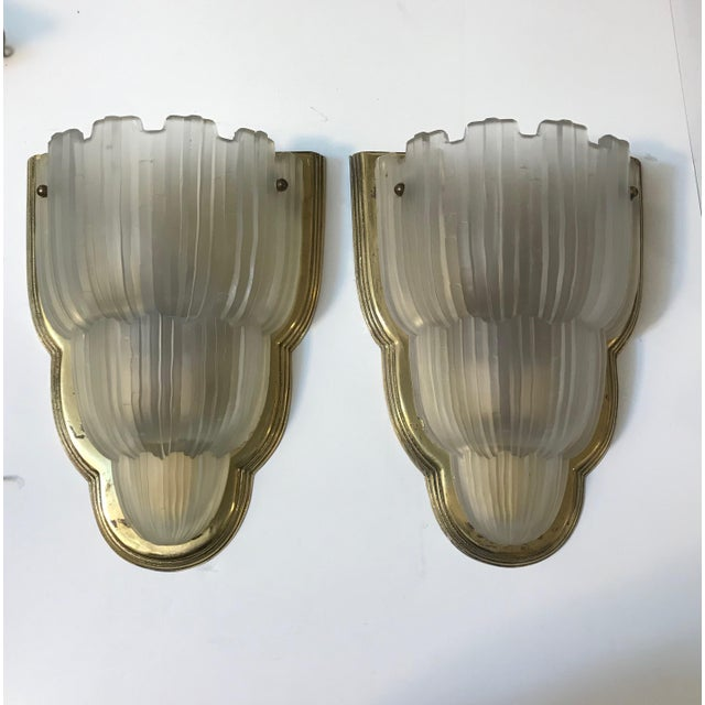 "A stunning set of four French Art Deco ""waterfall"" sconces from the 1930s signed by Marius Ernest Sabino (1878-1961). The..."