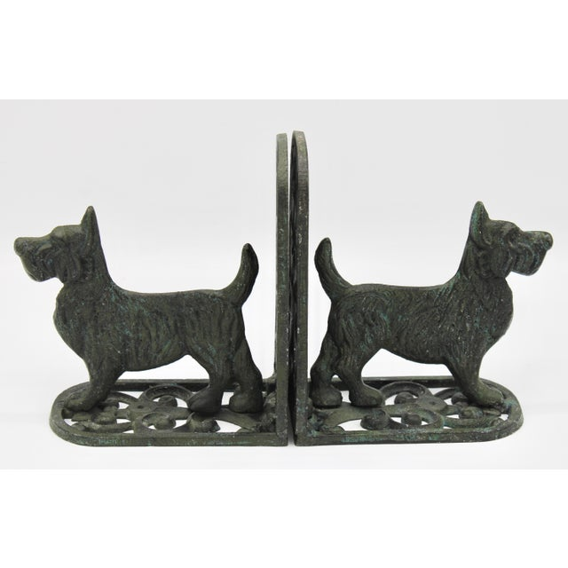 A superb pair of Mid Century West Highland Terrier Dog Bookends. This is a fine pair with wonderful verdigris patina....