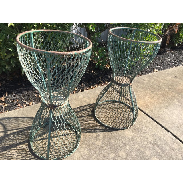Great pair of mid-century hourglass shaped wire planters from France, painted green