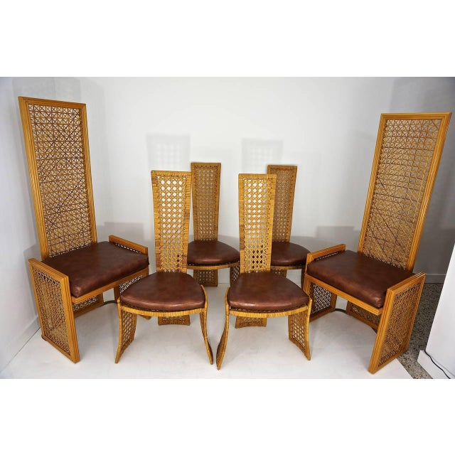 A stunning set of eight Italian rattan dining chairs by Vivai del Sud, Rome, Italy. Sold by Casa Bella in the 1980s. Very...