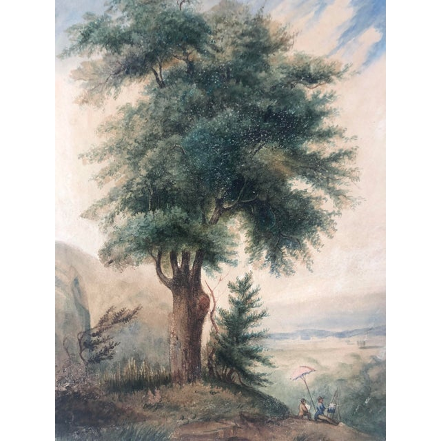 19th Century French landscape painting of two diminutive figures painting under an umbrella beneath a tree overlooking the...