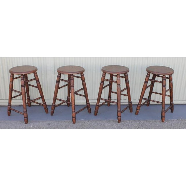 These four bar stools are from the Mid West and reminds you of the old west. They are in very sturdy and good condition....