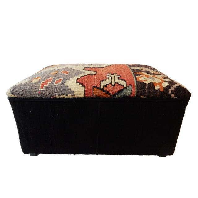 Superb elegant custom made ottoman made of a vintage hand made Tribal Kilim rug on the seat and black cotton mud cloth on...