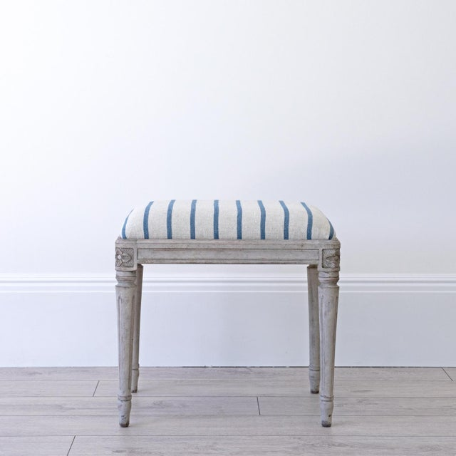 A bespoke Gustavian stool with decorative hand carved rose motif corners and tapered & fluted legs, faithfully reproduced...