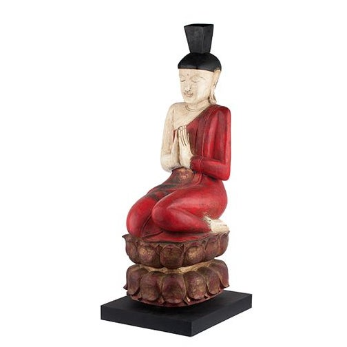 This lovely female monk sits on a black stand topped by a lotus and will be lovely in an outdoor space if it is in a...