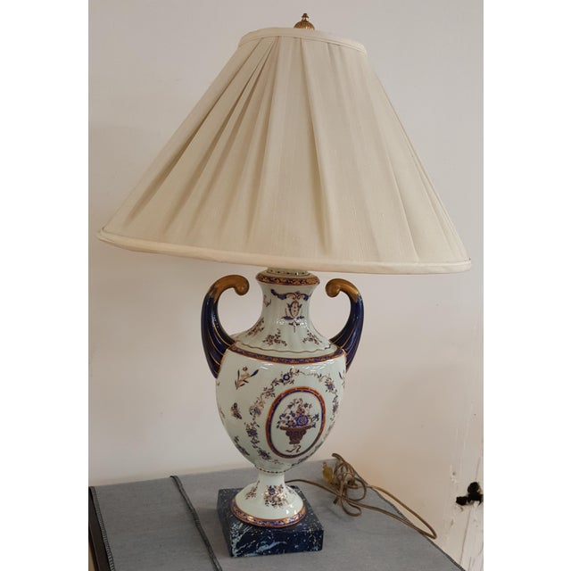 Beautiful lamp with gorgeous colors. A lot of blue. This is a showroom floor sample in excellent condition Shade is...