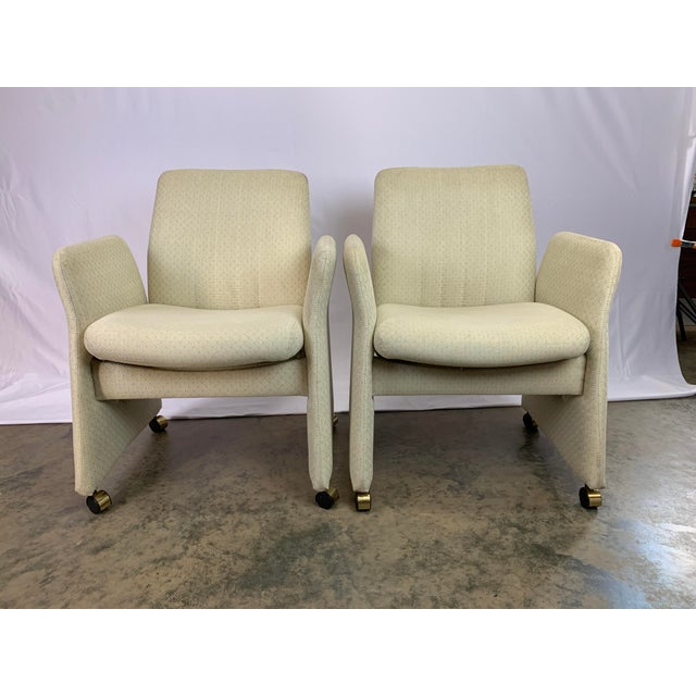 Add to your avant garde style profile with this rare set of Vladimir Kagan style rolling and tilting arm chairs by...