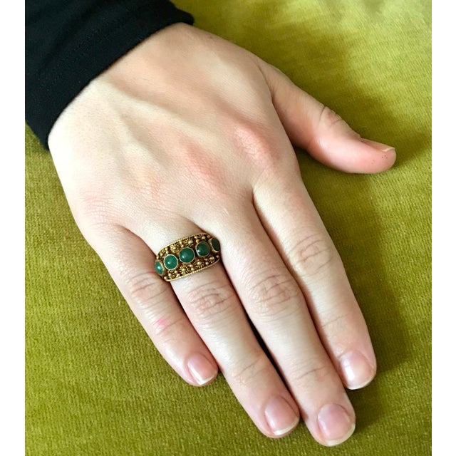 Circa 1940/50s Chinese gold-plated sterling silver band ring bezel set with five round jade cabochons and embellished with...