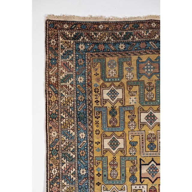 Antique Caucasian rug with unusual color palette. Even pile, ends complete, few small damages as shown. Gold background...