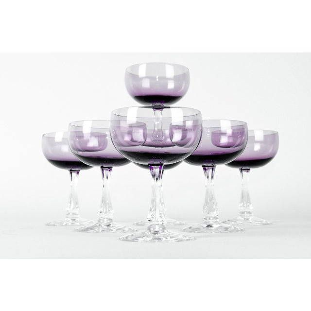 Vintage set of seven amethyst / purple color champagne crystal coupe with clear stem. Each coupe is in excellent...