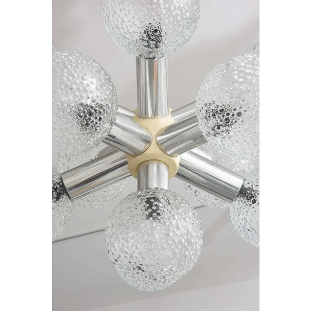 This stylish Mid-Century Modern chandelier dates to the 1960s, and it seems to take its inspiration from a star burst or...