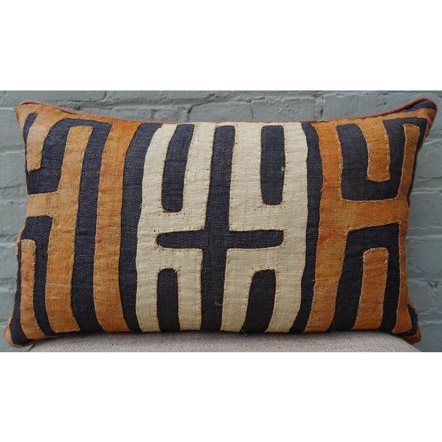 Rectangular African Kuba Cloth Pillow in Charcoal, wheat, & burnt orange design throughout. Burnt orange linen back with...