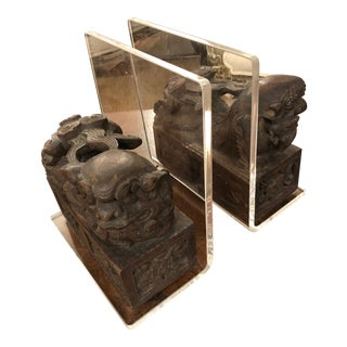 Carved Wood Foo Dogs and Lucite Bookends - a Pair For Sale