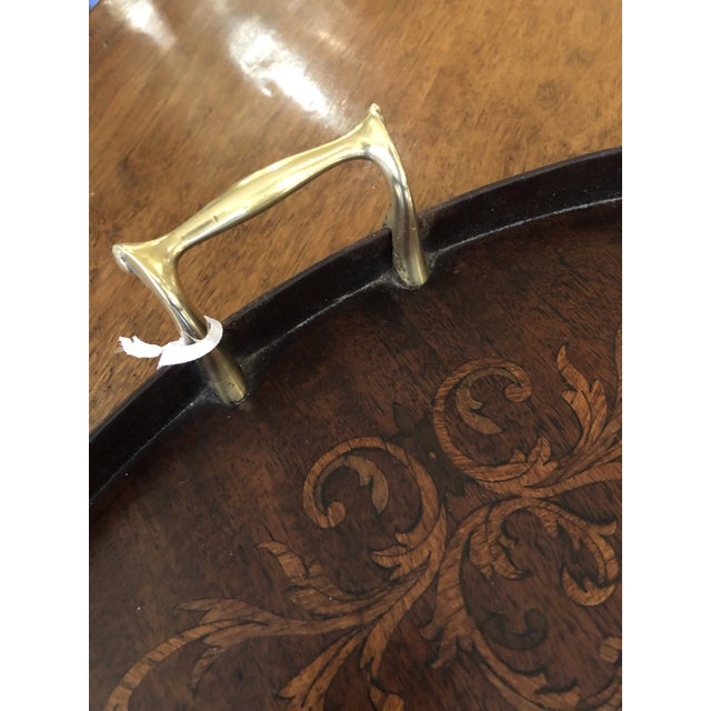 A beautiful vintage round wooden serving tray having inlay design and brass handles. Diameter of tray itself 19.5 Tray...