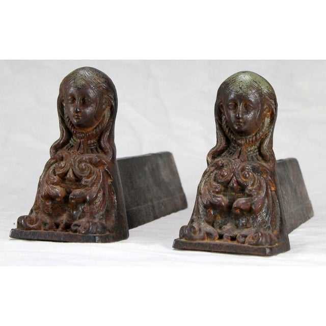 Is the figure adorning these antique cast iron andirons Marianne, a national symbol of the French Republic, standard of...