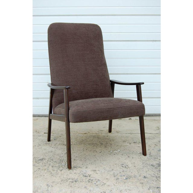 Newly restored and upholstered lounge chair in high-end Maharam dark slate green chenille fabric. Dark espresso birch...