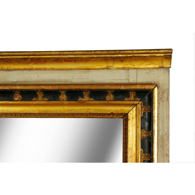 This large painted and parcel-gilt Italian mirror exudes character. The giltwood frame, carved with decorative elements,...
