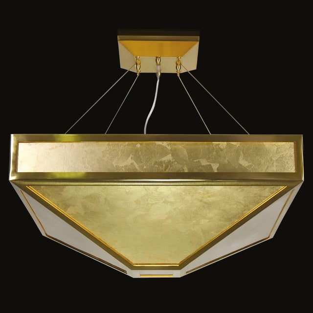 Italian modern chandelier with decorative Murano gold glass mounted on brushed gold metal finish by Fabio Ltd / Made in...