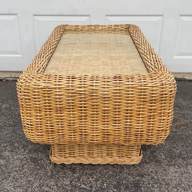 Vintage woven natural rattan boho chic coffee table. This piece has such a unique shape featuring a large rounded edge...