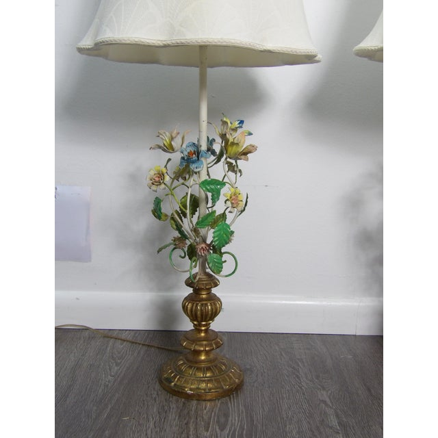 Pair of Vintage Italian Tole Lamps. This nice pair feature turned wood base in gold paint , metal tole florals in blue and...