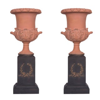 Neoclassical Terracotta Urns on Decorated Plinths - a Pair For Sale