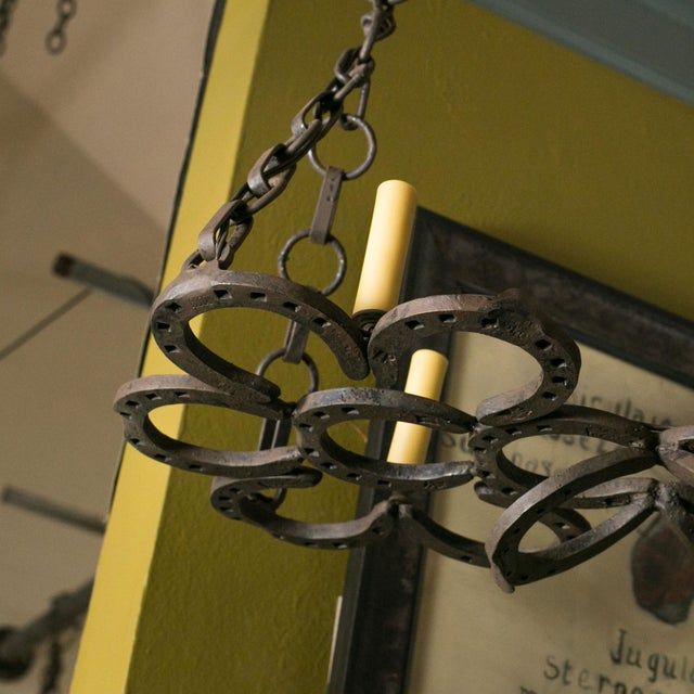 Wrought iron horseshoe chandelier. This rustic French light is completely handmade of 19th century hand-forged horseshoes....