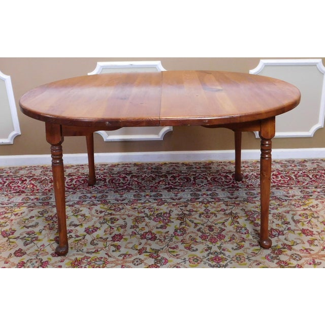 Description: This is a very classic and common light American knotty pine Colonial style kitchen or dining room table with...