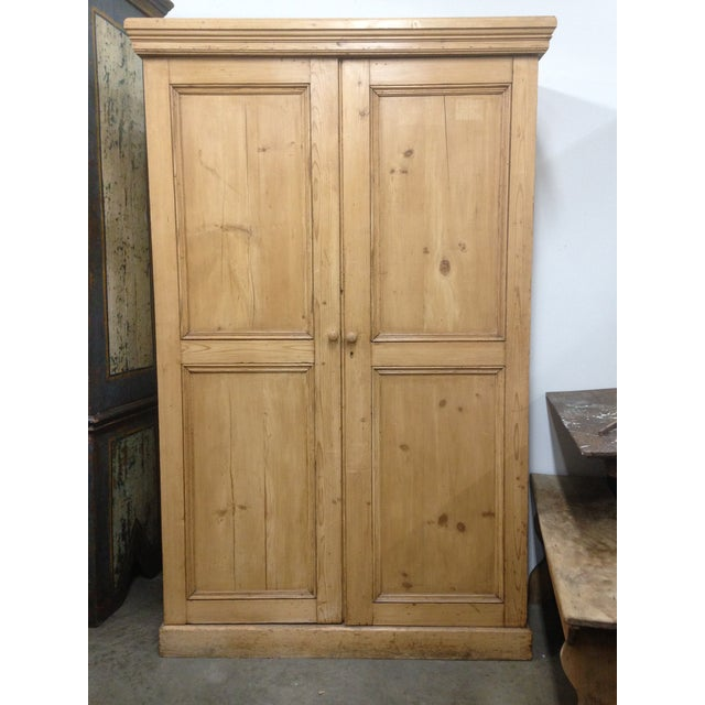 Gorgeous large rustic antique armoire, with double panel doors, a crown, and wooden handles. Inside you will find the...