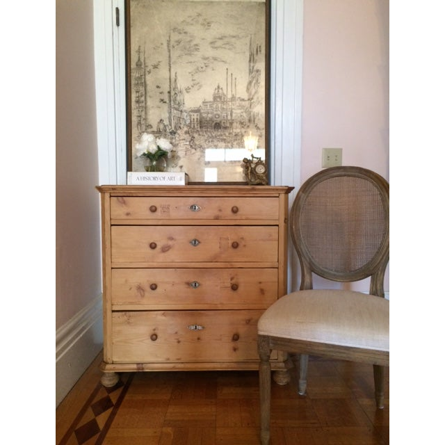 This lovely antique Scandinavian pine commode has a wax finish to bring out the warmth of the wood. The dresser drawers...