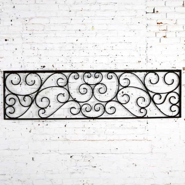 Gorgeous antique swirled design piece of wrought iron. It is, and was originally, a railing piece but could be used as a...