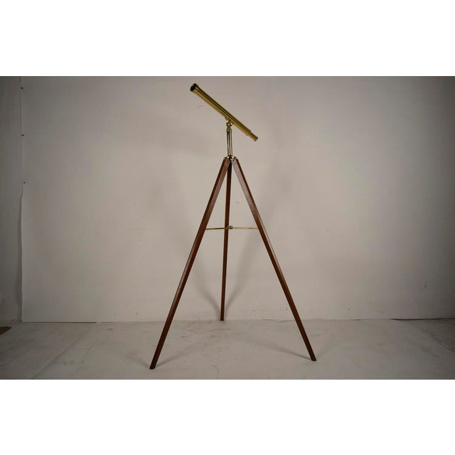 This is a 1970's Van Cort Instrument Makers Telescope. The telescope and mid section are crafted from brass and sits upon...