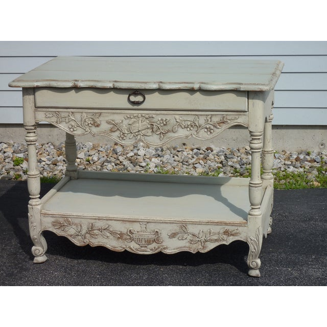 French country two tier server with carved frieze decoration, one drawer, pale celadon paint.