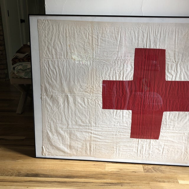 Very old and well taken care of Red Cross flag. Currently framed in an inexpensive poster frame that is very light...