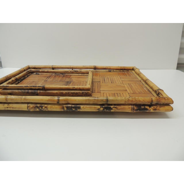 Set of two faux tortoise bamboo serving trays. Sizes: 18.5 x 12 x 2H and 9 x 6.5 x 1H.