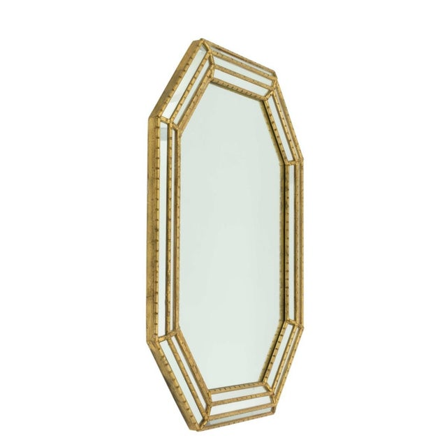Gold octagon framed mirror with faux bamboo frame and inset mirrored panels by Labarge. USA, circa 1980. Dimensions: 42...